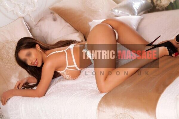 Ashley on bed Chelsea london tantric