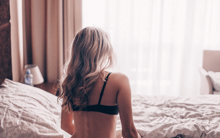 a woman's back in a tantric massage