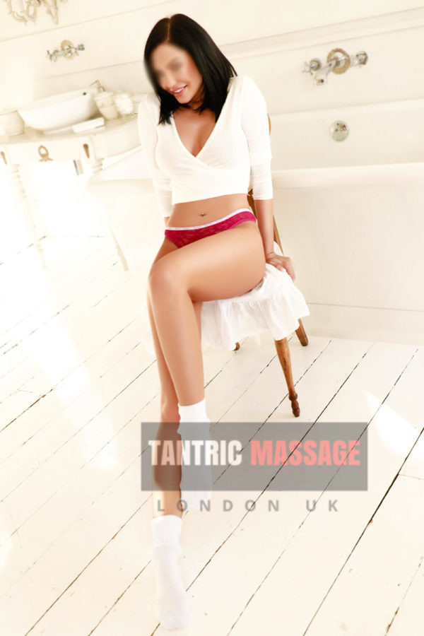 Kylie Red Undy Sitting on Chair tantric massage Paddington & Marylebone